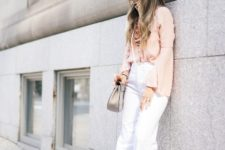 With white flare pants, high heels and gray bag