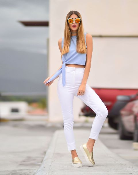 With white high-waisted pants and golden and white shoes