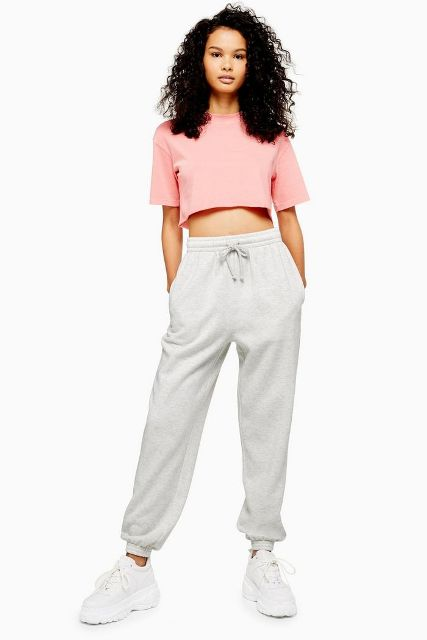 With white jogger pants and white sneakers