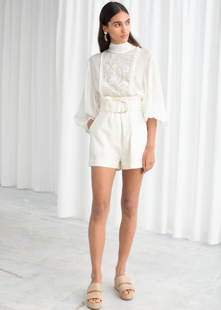 With white lace blouse and beige platform sandals