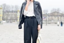 With white lace blouse, black leather jacket, loose pants and beige bag