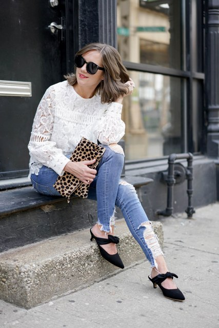 With white lace blouse, leopard printed clutch and distressed skinny jeans