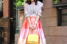 With white lace blouse, yellow bag and low heeled shoes