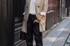With white loose shirt, black leather cropped trousers, bag and platform lace up shoes