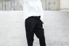 With white loose sweatshirt and black ankle boots