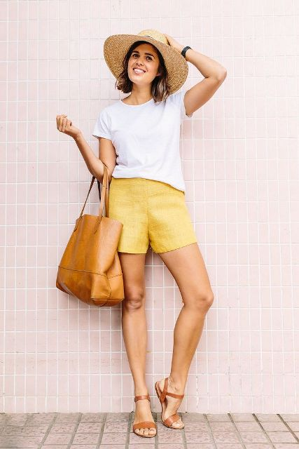 With white loose t shirt, wide brim hat, brown tote bag and brown shoes