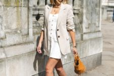 With white mini dress, brown bag and ankle strap shoes