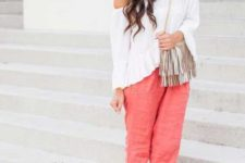 With white off the shoulder blouse, wide brim hat, fringe bag and flat sandals