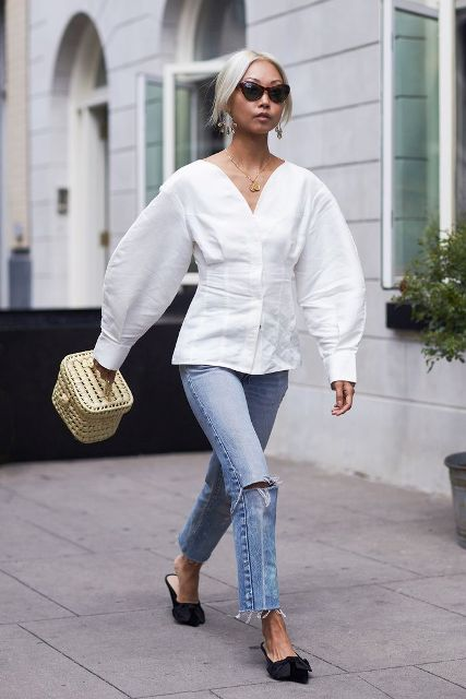 With white oversized blouse, beige bag and jeans