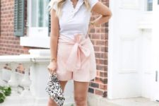 With white ruffled blouse, printed clutch and ankle strap shoes