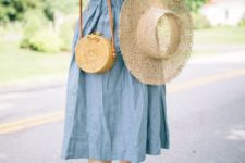With white ruffled blouse, wide brim hat, straw bag and beige shoes