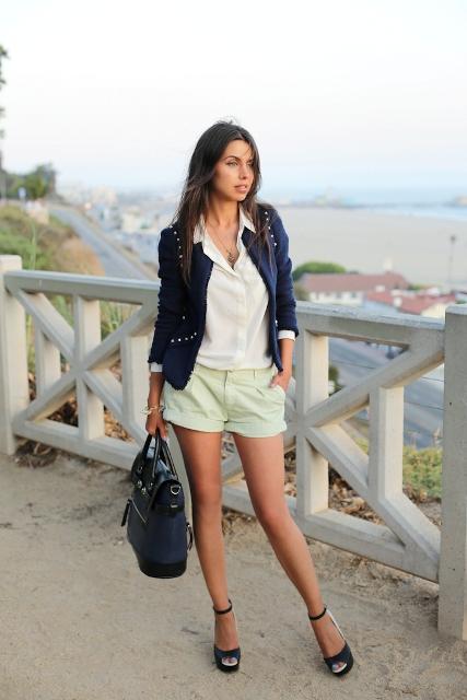 With white shirt, navy blue blazer, black bag and velvet shoes