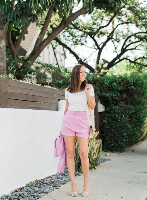 With white shirt, pale pink bag, high heels and pink blazer