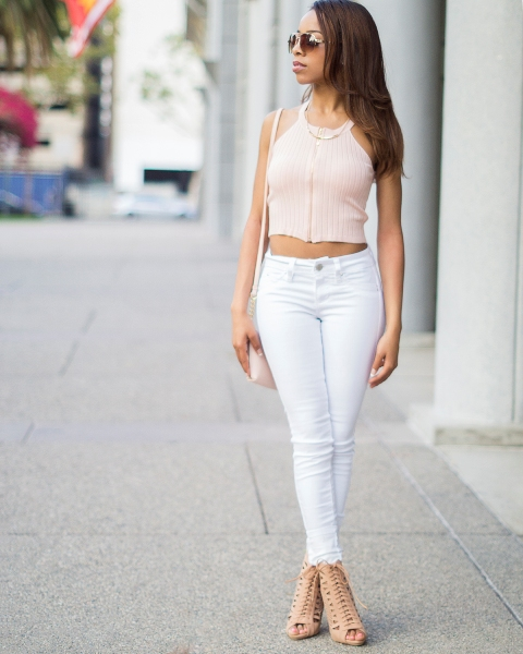 With white skinny pants, beige cutout shoes and pastel colored bag