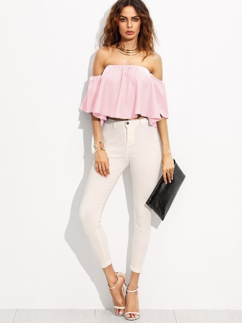 With white skinny pants, black clutch and ankle strap shoes