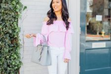 With white skinny pants, gray leather bag and lace up shoes