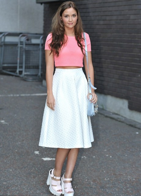 With white skirt, light blue bag and platform sandals