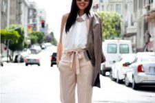 With white sleeveless shirt, leather jacket and high heels