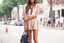 With white sleeveless top, ankle strap shoes and navy blue bag