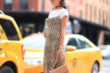 With white t-shirt, beige chain strap bag and patent leather boots