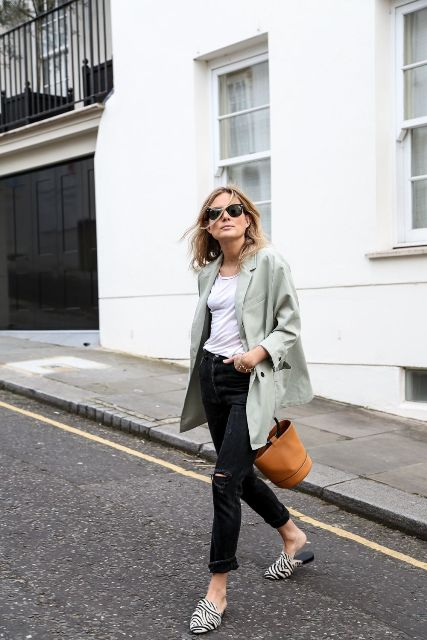 With white t-shirt, black jeans, loose blazer and brown bag