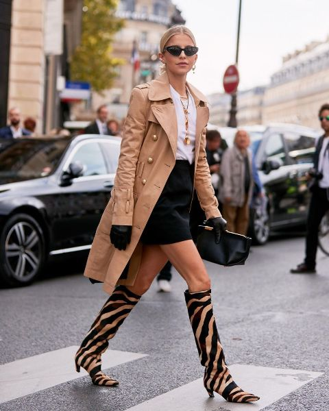 With white t-shirt, black mini skirt, black clutch and light brown trench coat