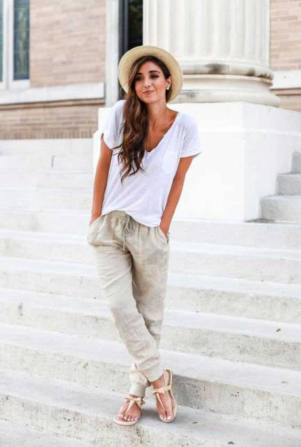 With white t-shirt, flat sandals and hat