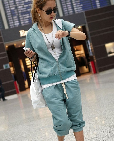 With white t-shirt, mint green sporty pants and white tote bag