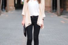 With white t-shirt, pastel colored cardigan, black skinny pants and black clutch