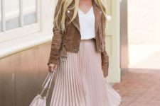 With white top, brown suede jacket, white tote bag and beige sandals