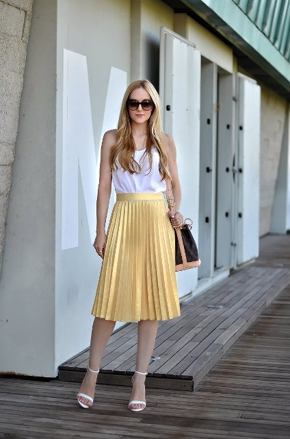 With white top, two colored bag and white heeled shoes