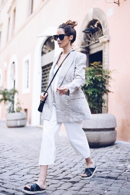 With white top, white cropped pants, crossbody bag and black flat sandals