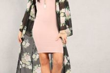 With wide brim hat, pastel colored mini dress and beige shoes