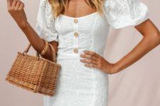 a beautiful white lace fitting over th eknee dress with puff sleeves and a bodice on buttons for a retro feel