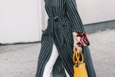 a black and white striped midi shirtdress, white pants, burgundy flats and a bucket bag in yellow