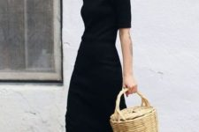 a black fitting minimalist midi dress with a high neckline and short sleeves, white sneakers for a monochromatic look