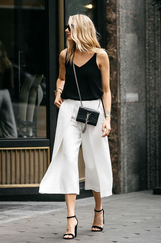 a black strap top, white culottes, black heels and a small bag for a chic summer look