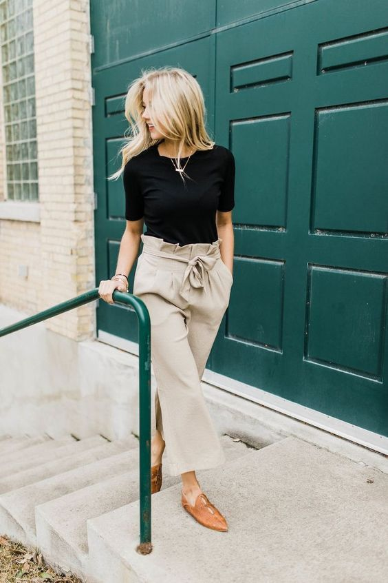 a black tee, neutral high waisted pants, tan flat mules for a very simple yet chic look