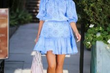 a blue lace off the shoulder puff sleeve mini dress with a ruffle skirt, laser cut shoes and a blush bag