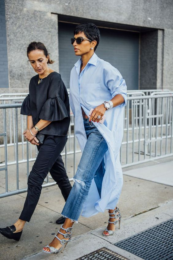 a blue oversized shirtdress, blue ripped jeans, catchy bold heels and statement accessories