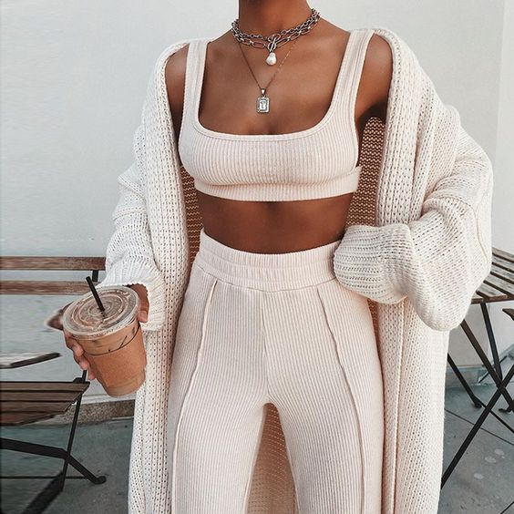 a blush pink loungewear set with a crop top and long pants plus a neutral oversized cardigan