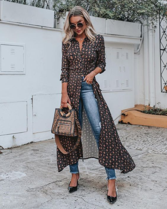a bold and catchy printed midi shirtdress, blue skinnies, black kitten heels and a printed bag