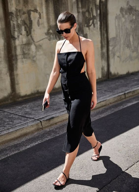 a bold black midi sheath dress with a strap top, an open back and black Greek sandals for a party look