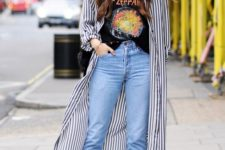 a bold printed tee, blue jeans, black booties and a striped shirtdress for a bold and rock-inspired look