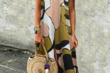 a bright minimalist abstract print sleeveless midi dress, blue sandals and a large wicker bag to rock