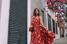 a bright red and pink printed midi dress on spaghetti straps, with a midi skirt, tan mules and a vintage bag