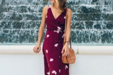 a comfortable purple floral wrap midi dress with thick straps and brown mules plus a saddle bag