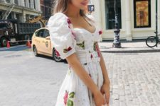 a cute floral print lace mini dress with a depe neckline, puff sleeves and a neutral bag for a date