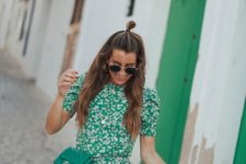 a green floral mini dress with a ruffle skirt, a high neckline and short sleeves, a matching waist bag for every day