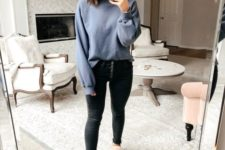 a grey sweatshirt, black skinnies, grey slippers for a comfy and cozy quarantine look